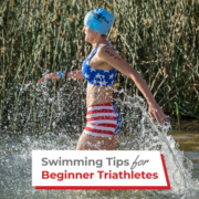 Female swimmer enters Decker Lake at Rookie Triathlon. Text on design reads Swimming Tips for Beginner Triathletes. Learn more at https://therookietri.com/beginner-triathlete-swimming-tips/