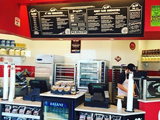 Front counter and menu board at a Jimmy John's store
