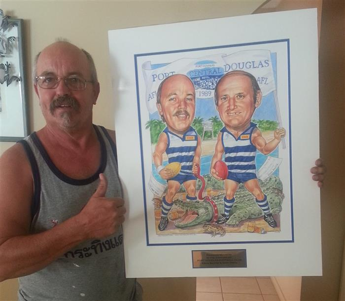 Ernie with a caricature of him and Andy. Founding members of the Port Douglas Footy Club