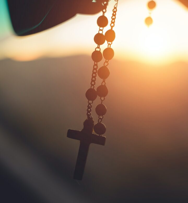 silhouette-photography-of-hanging-rosary-2081128