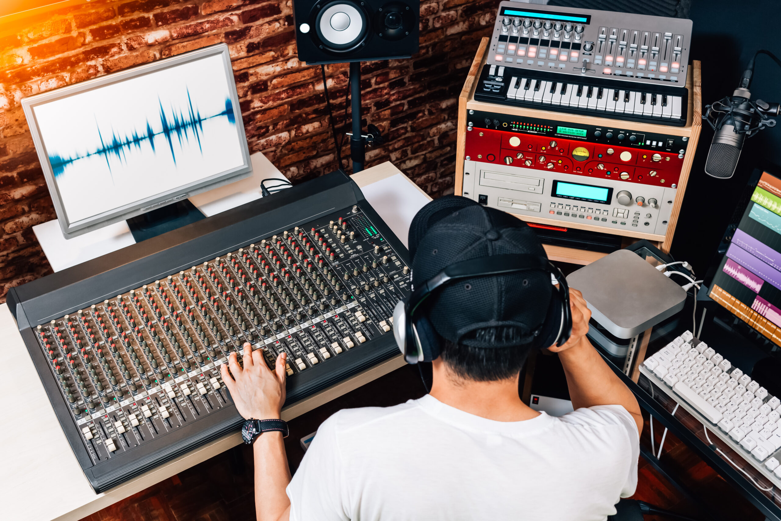 music producer, sound engineer, composer in studio. recording, broadcasting, audio video editing