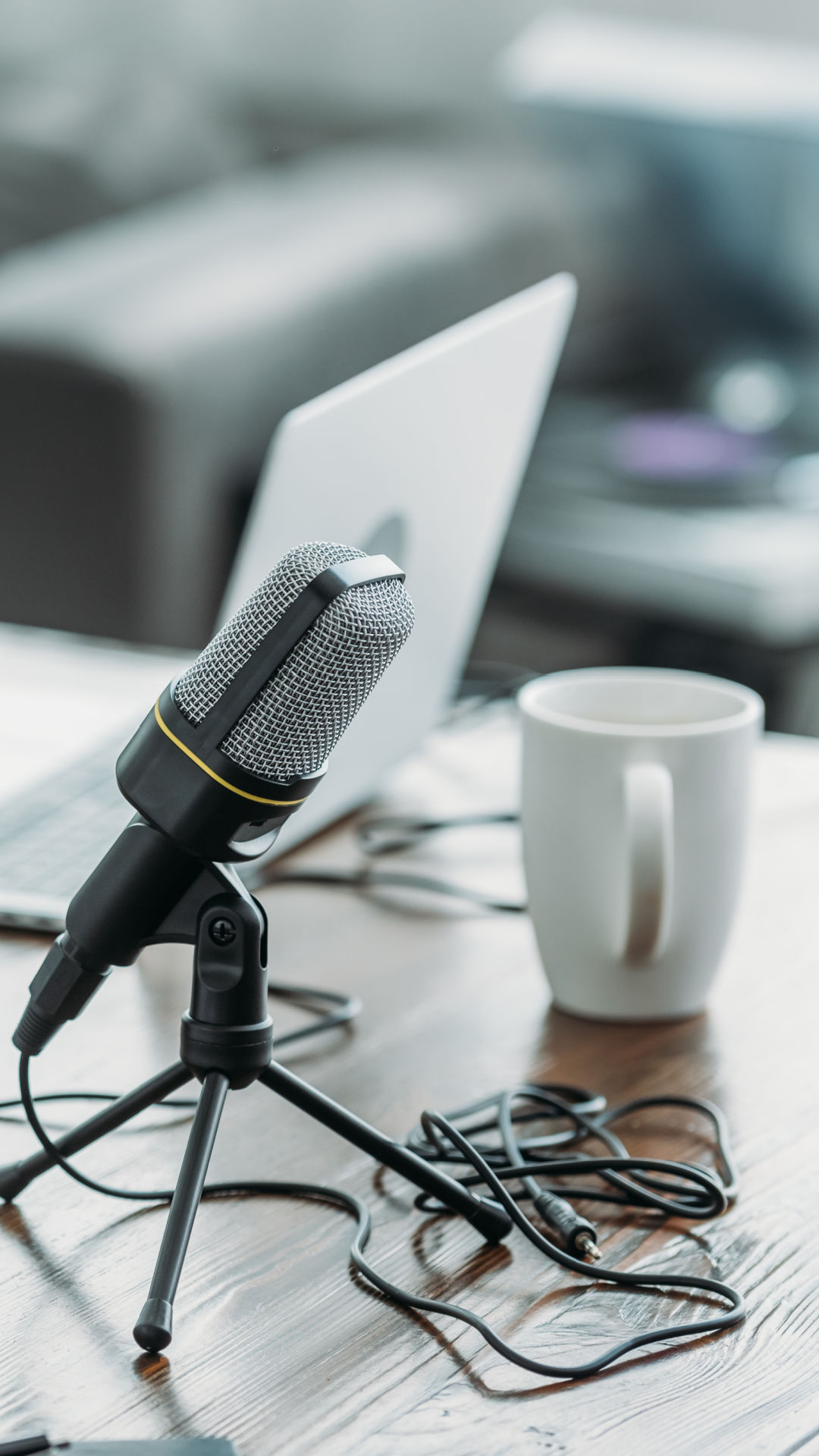 mircophone and coffee cup recording podcast IBLP