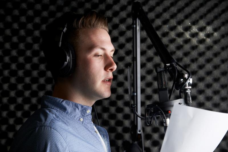 Man In Recording Studio Talking Into Microphone