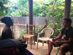 Scott meeting with one of the micro loan recipients