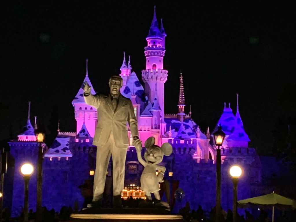 Partners Statue and Sleeping Beauty Castle at night - Disneyland - Disney Things We're Most Thankful For