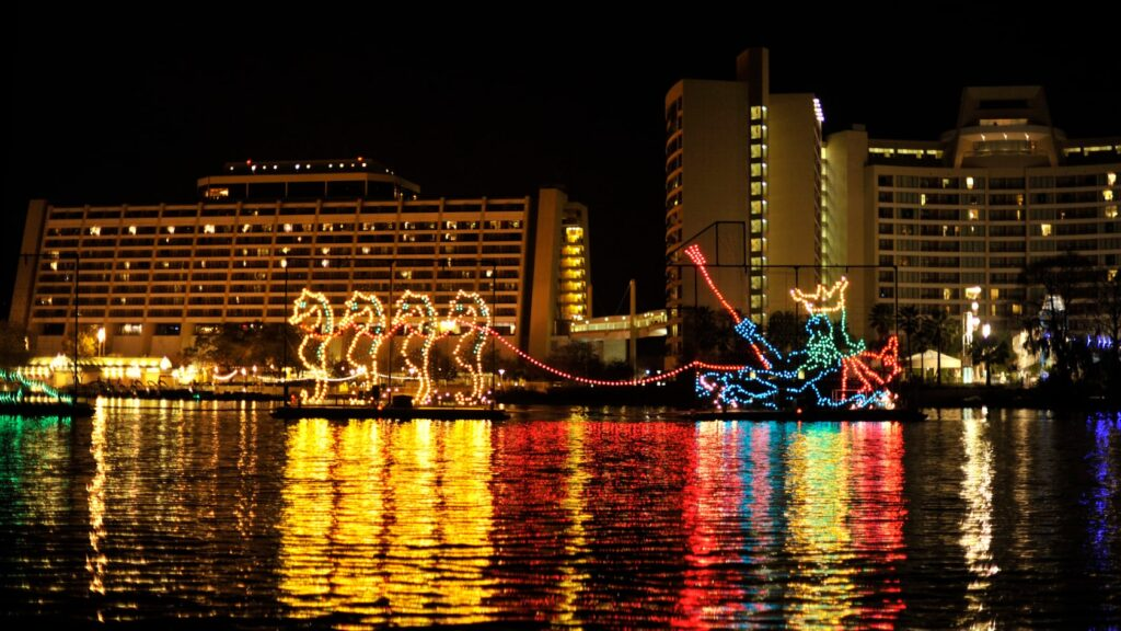 Electrical Water Pageant in from of Disney's Contemporary Resort - What Disney At The Holidays Means To Us