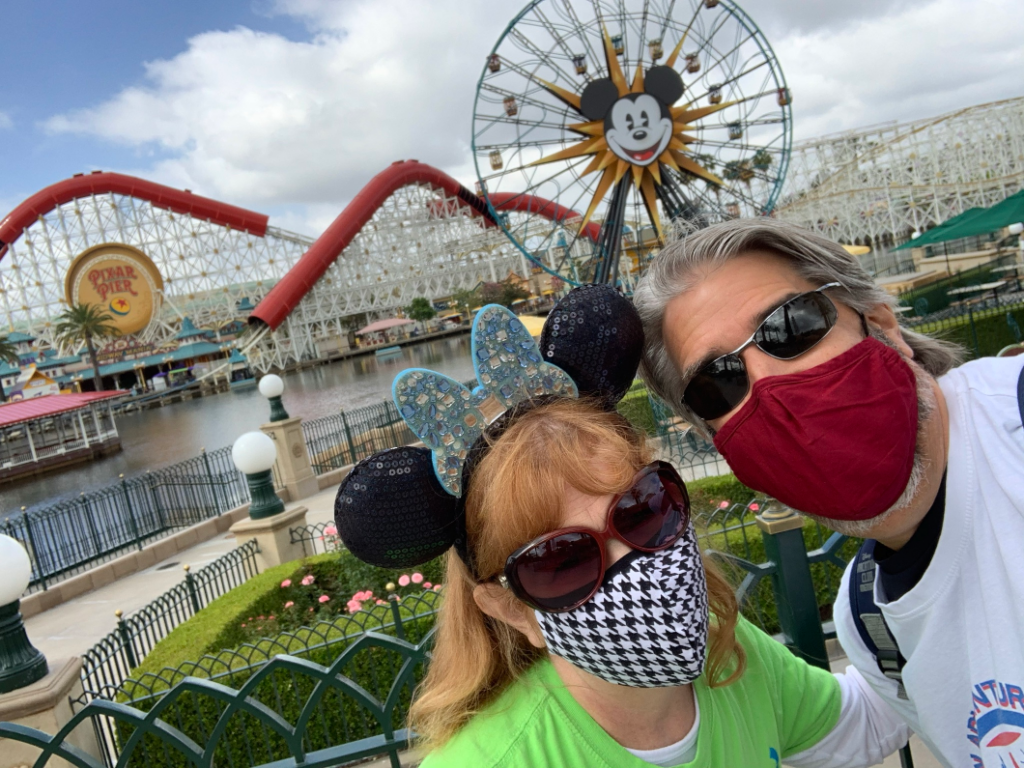 Tom and Michelle with Pixar Pier in the background - Our Return To Disneyland For Re-Opening Weekend