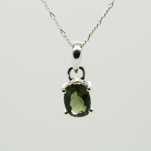 Faceted Moldavite Oval -Shaped Pendant in Silver