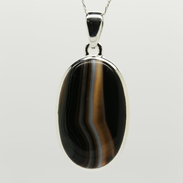 Black Banded Agate Oval -Shaped Pendant in Silver