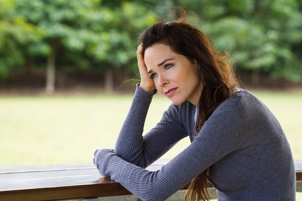 Sad and depressed woman outside