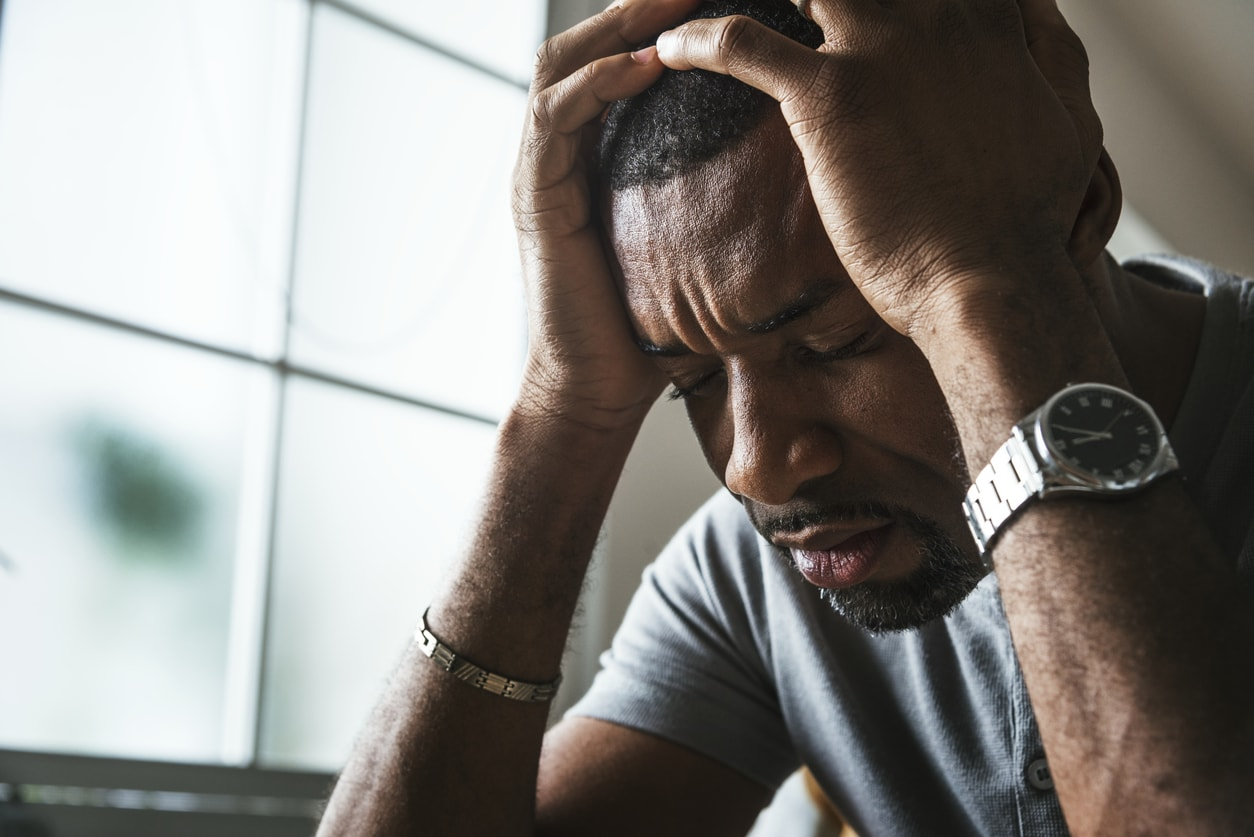 African American man feeling very stressed and anxious
