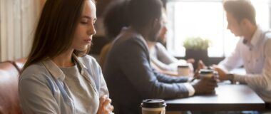 Woman with social anxiety in coffee shop