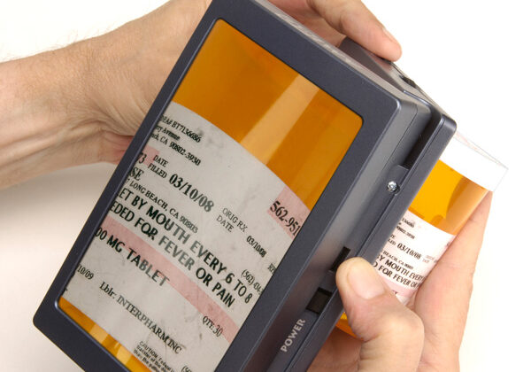 An electronic magnifier is used to read prescription medication