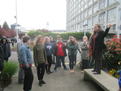 Tanya March leads a group on the Slabtown history tour