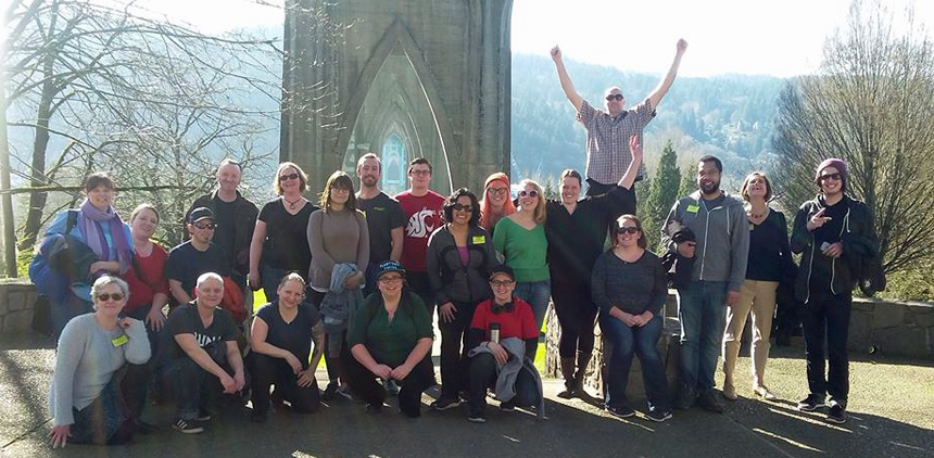 Tour group in front of St. Johns Bridge. Twenty-one guests and one guide. This was staff from the local New Seasons store.
