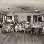 Historical photo of a children's Bible class at St Johns Community Center