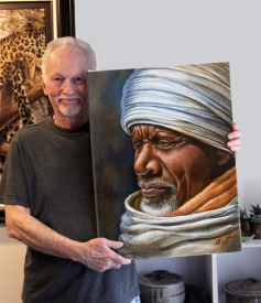 Artist Hoyt Smith holding Aleka Moges' Painting
