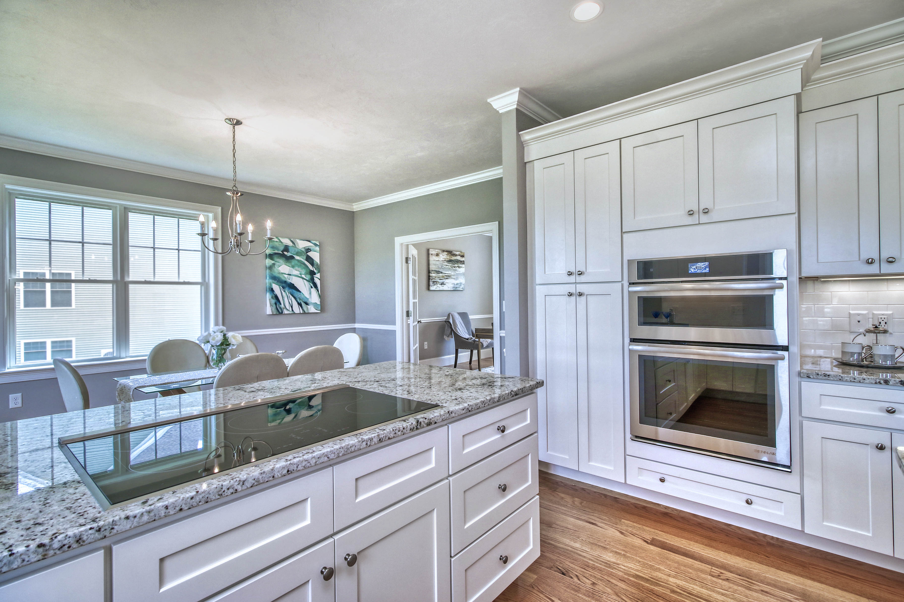 Pastel grey walls with an open space area between the dining room and the kitchen