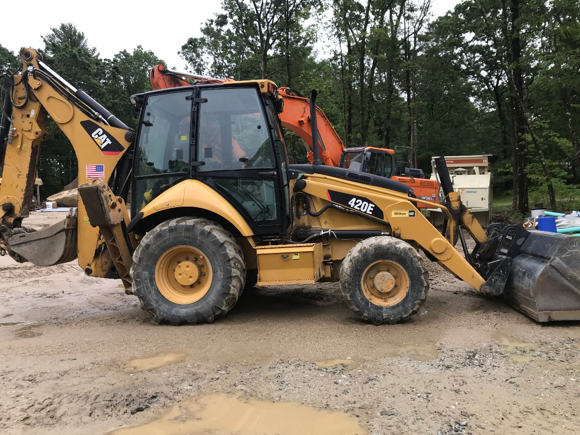 Yellow CAT front and backhoe loader