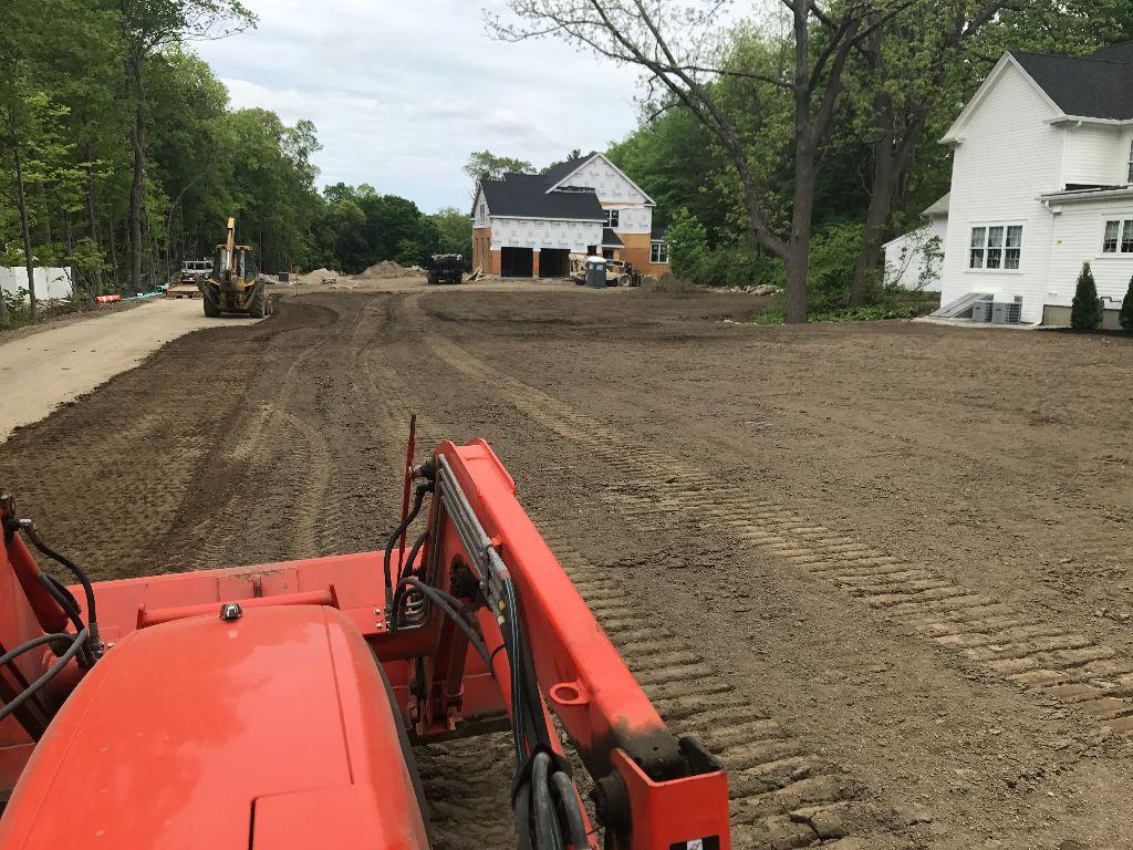 Dirt road between two houses