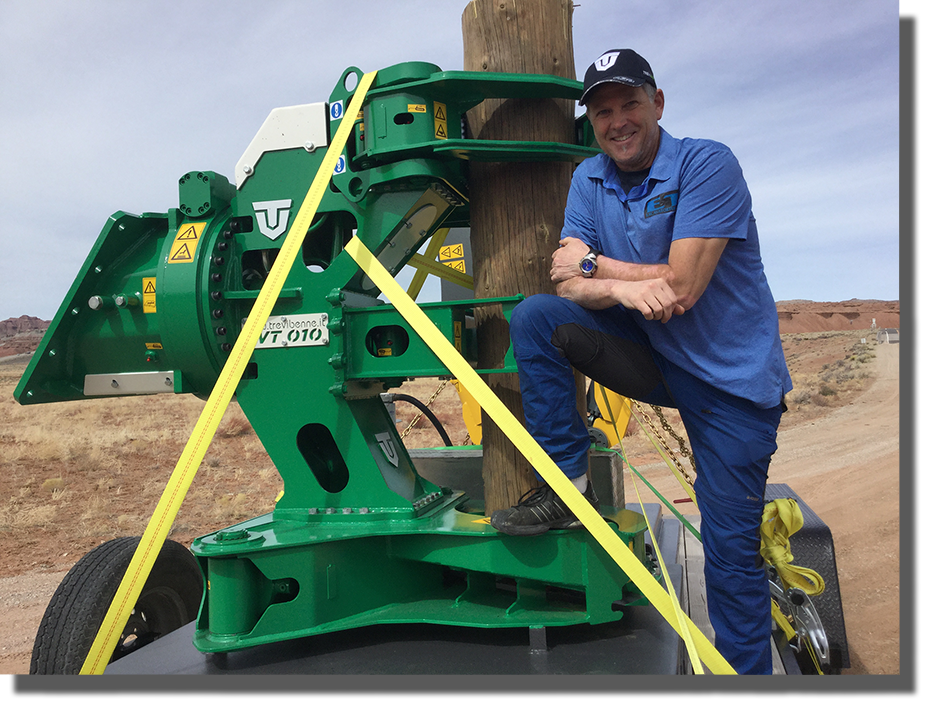 Mark Gigstad next to Tree Shear attachment