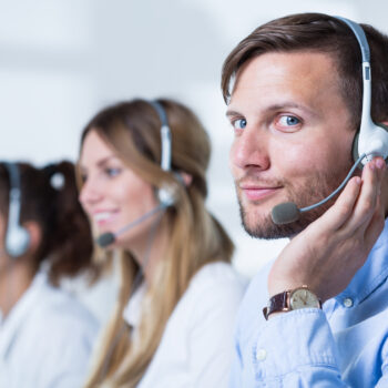 Close-up of support phone operators in headset