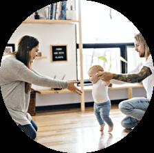 baby walks on hardwood floor