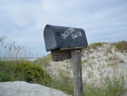Mailbox in sand dunes
