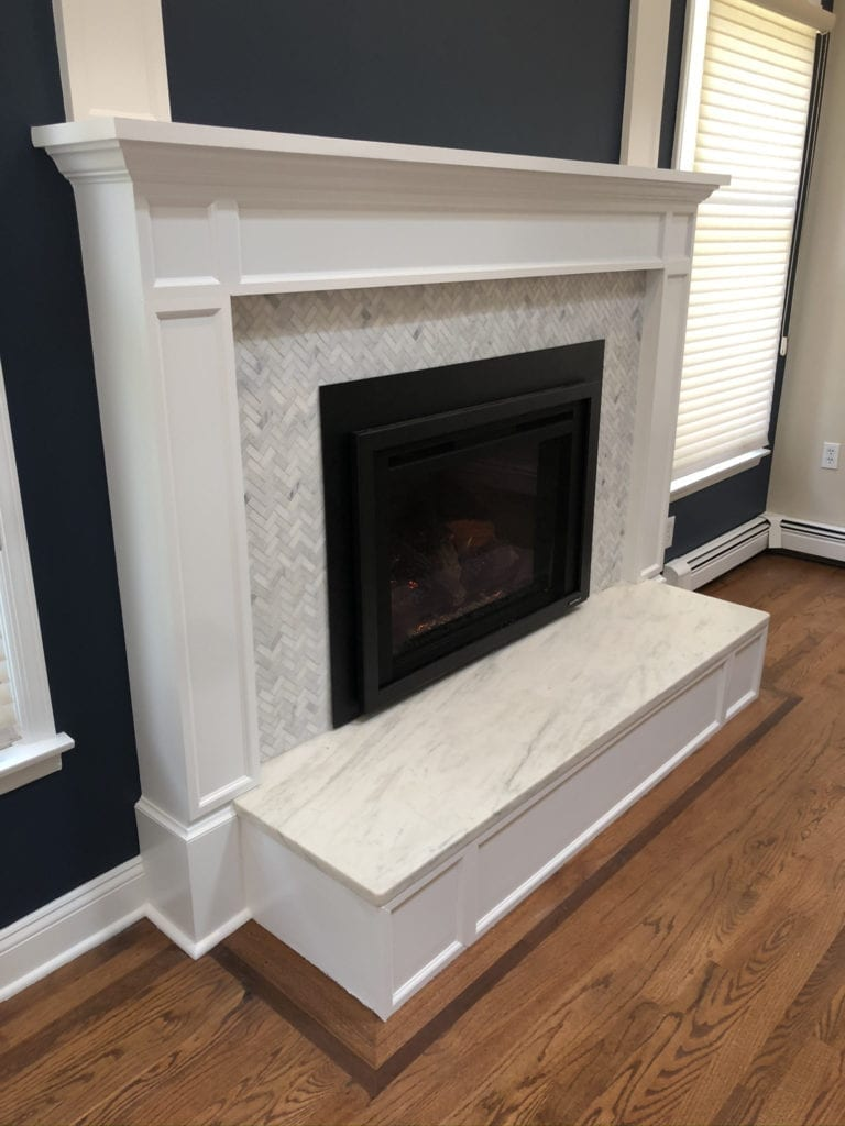 Heat N Glo Escape gas fireplace insert with white mantel