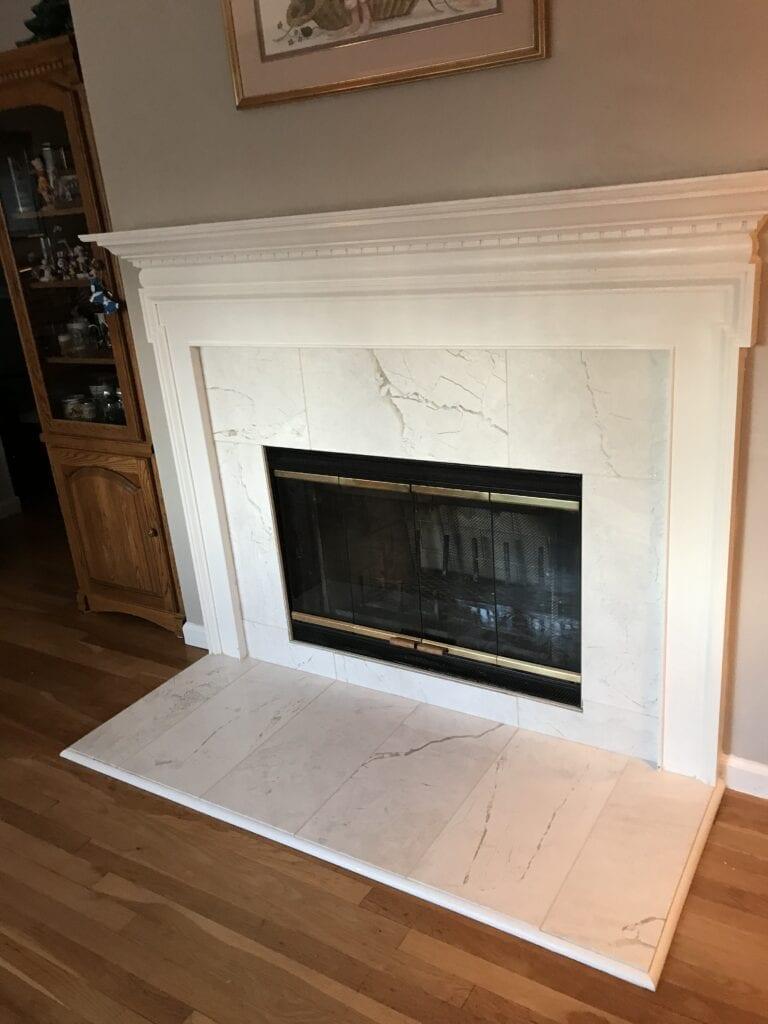 White marble wood burning fireplace