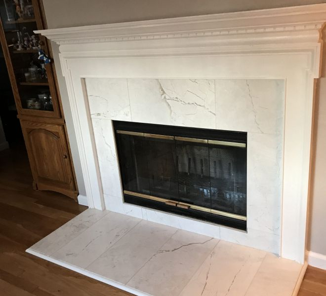 White marble wood burning fireplace