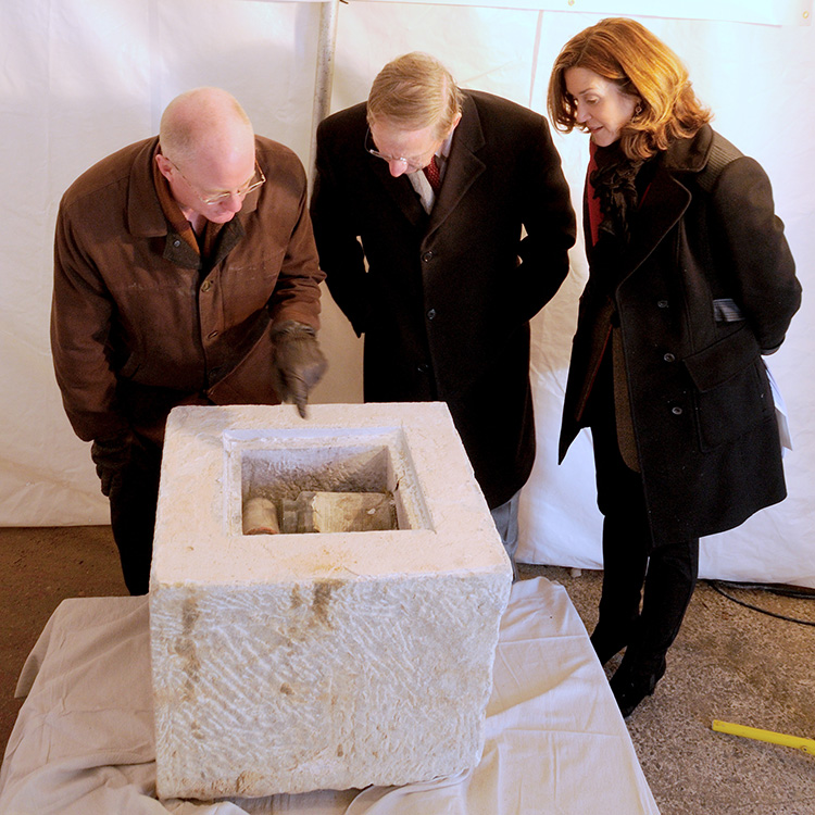 Mount Vernon Place Conservancy officials examining 1815 artifacts: Lance Humphries, Chair of Restoration Committee, Richard Thomas, Head of the Development Committee, and Faith Millspaugh, Vice President and Bicentennial Co-Chair.