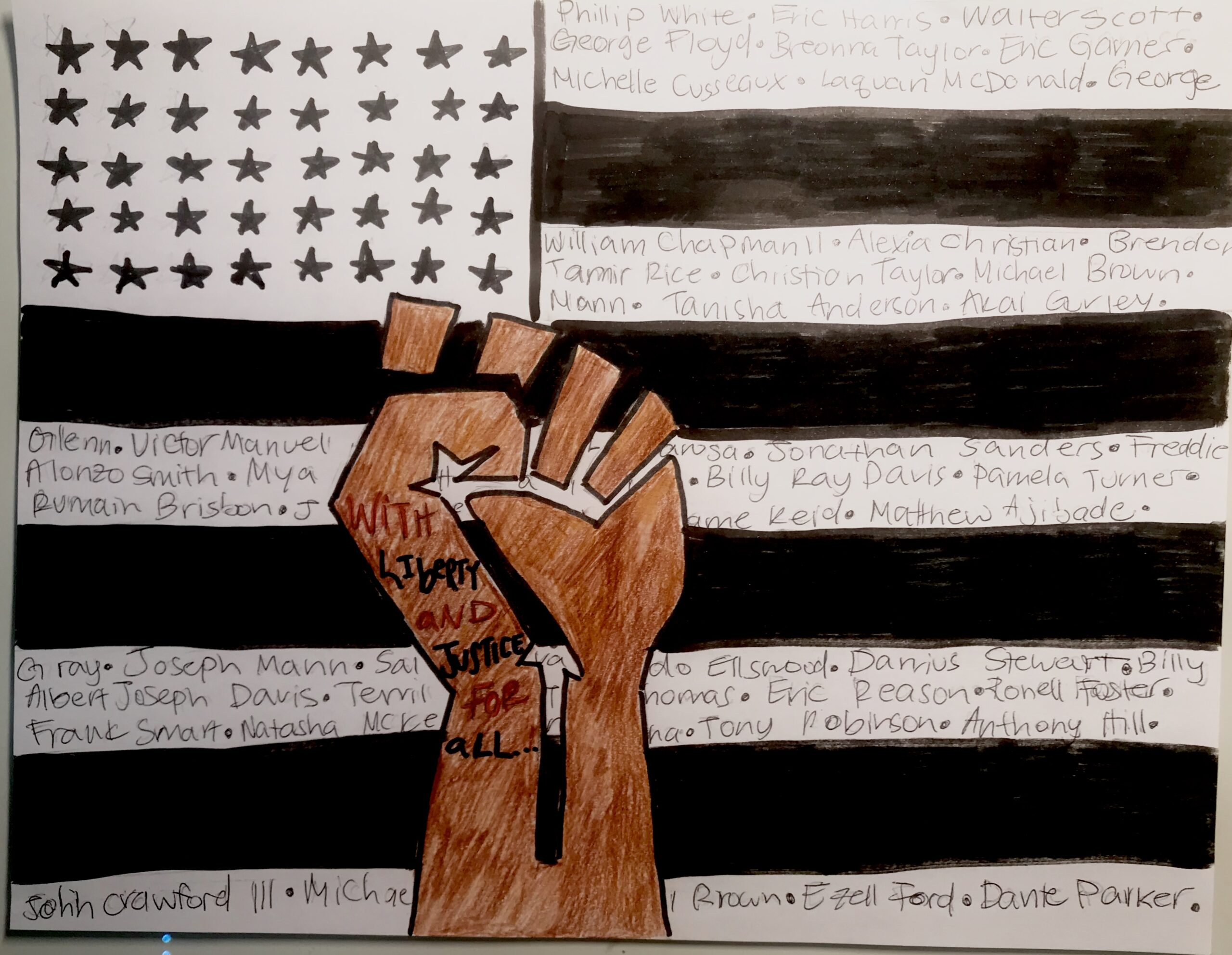 """Our country's values are based on justice and freedom for all, but clearly, our nation is not following those principles. Hence, the """"With liberty and justice for all"""" from the pledge of allegiance written on the fist. The names written on the stripes of the flag, are just a few of the victims of police brutality within the last few years. There were hundreds more, but I could only fit a few names."""