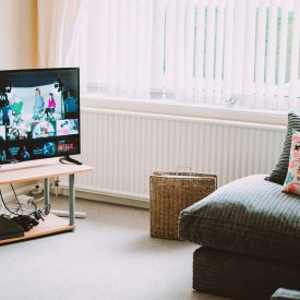 turned-on-flat-screen-smart-television-ahead-1444416