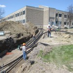 Geothermal supply and return pipe going to the building