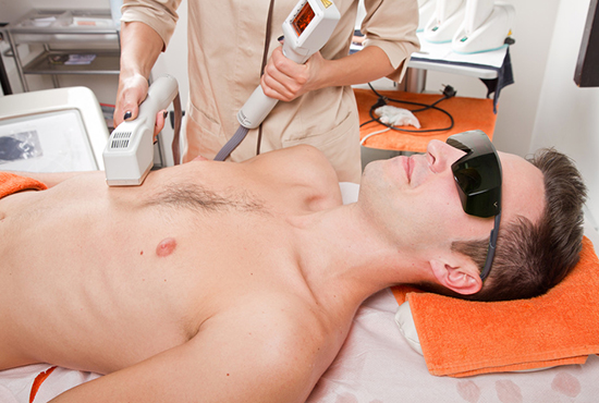 Man receiving laser epilation