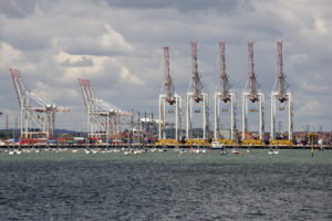 Container terminal cranes line a deepwater berth at DPWorld Southampton Port UK
