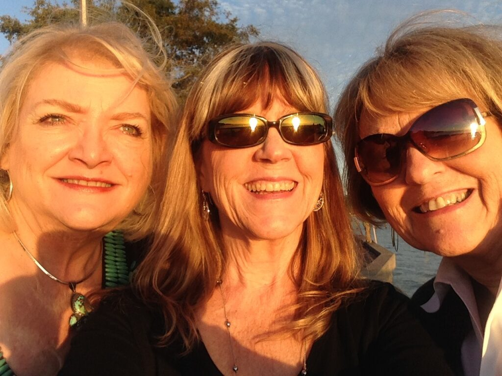 Ren, me and NancyKay at sunset on the Fairhope Pier