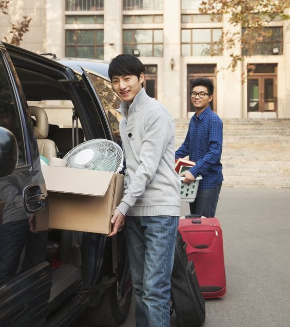 New College Students Moving Into Dormitory In America