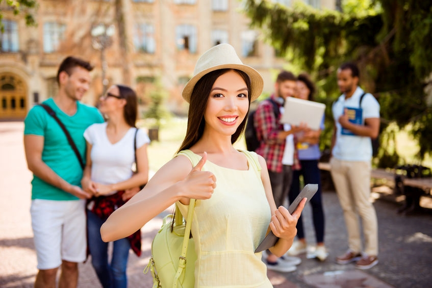 Asian student happy to learn she has been admitted to her first choice school in America