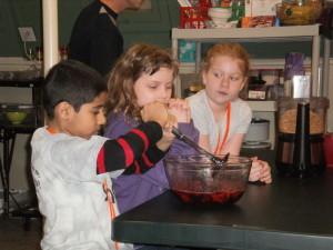 Neel mashing up the berries