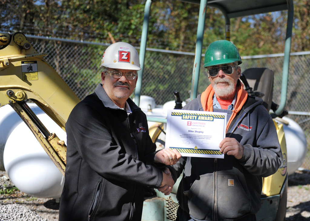 Mike Shepley is given his 50,000 safety hours award.