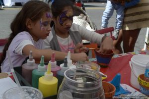 Young attendees paint flower pots at Bronx Summer Fest 2016.