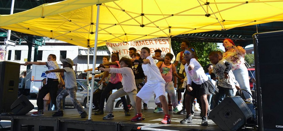 Young dancers and KR3T's delight the crowd onstage at the 2016 Bronx Summer Fest.