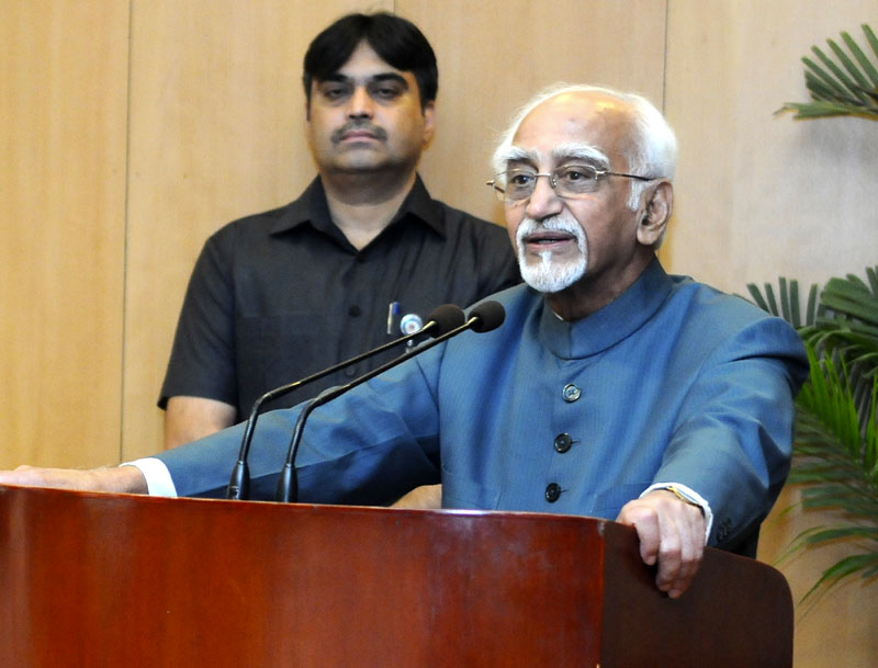 Vice President,  M. Hamid Ansari addressing the gathering after releasing the book 'The Quest for Muslim Reservation