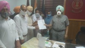 AAP holds protest demands Blue cards restoration