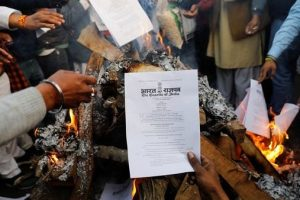 Farmers burn legislation in show of defiance