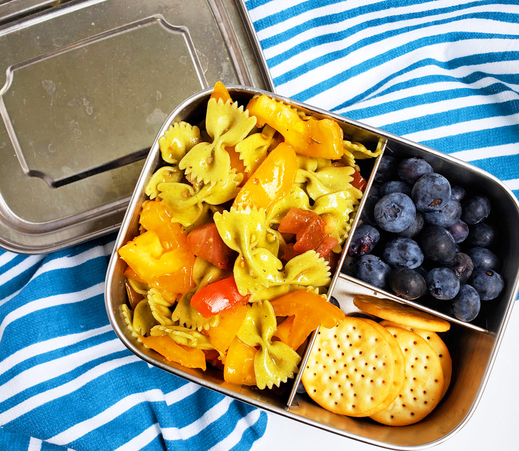 Easy Heirloom Tomato Bow-Tie Pasta in a bento box with blueberries and crackers