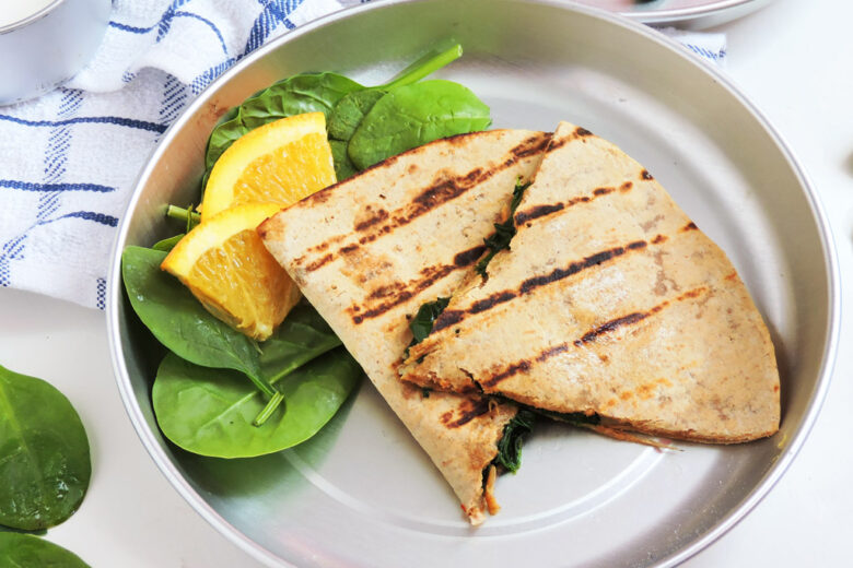 Cheesy Spinach Whole Wheat Quesadillas, grilled on a metal plate