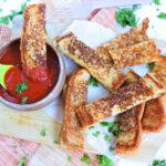 Garlic Toast Grilled Cheese Sticks dipped in marinara sauce